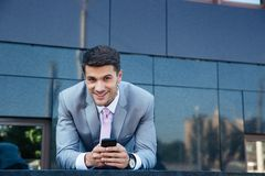 Businessman using smartphone outdoors Royalty Free Stock Photography