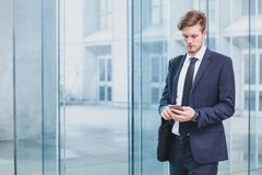 Businessman using smartphone royalty free stock image