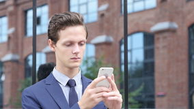 Businessman Using Smartphone for Searching Information, Standing Outdoor stock video footage