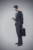 Businessman using a smartphone Stock Photography