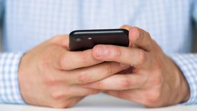 Businessman using smartphone for text messaging stock video
