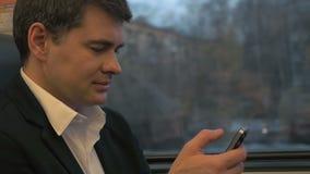 Businessman Using Smartphone in Train stock video
