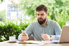 Businessman Using Smartphone for Work Stock Images