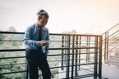 Businessman using smartphone before working in morning royalty free stock photography