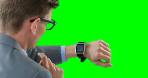 Businessman using smartwatch. Against green background stock video