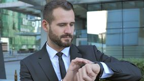 Businessman Using Smartwatch for Browsing Internet. 4k , high quality stock video footage