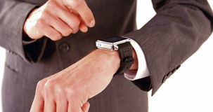 Businessman using smartwatch stock video footage