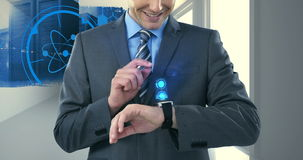 Businessman using smartwatch. In office stock footage