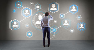 Businessman using social network interface on a wall 3D renderin Stock Image