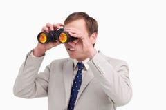 Businessman using spy glasses Stock Photo