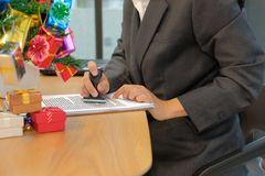 businessman using stamper for stamping approved on contract agreement document during christmas royalty free stock image
