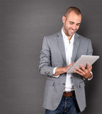 Businessman using tablet Royalty Free Stock Photos