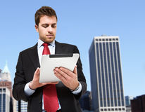 Businessman using a tablet Royalty Free Stock Images