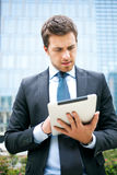 Businessman using a tablet Royalty Free Stock Photography
