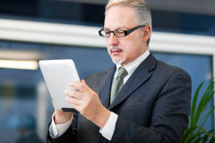 Businessman using a tablet Stock Photo