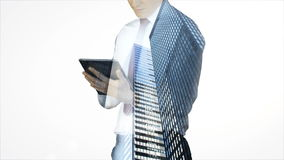 Businessman using tablet with cityscape overlay stock footage