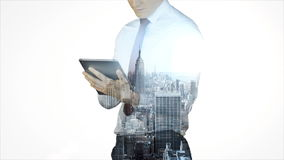 Businessman using tablet with cityscape overlay stock video