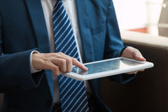 Businessman using a tablet Stock Photos