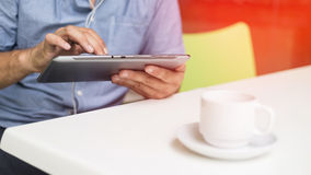 Businessman using tablet in coffee break Royalty Free Stock Images