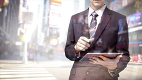 Businessman using tablet computer with city overlay stock video footage