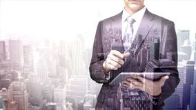 Businessman using tablet computer with city overlay stock footage