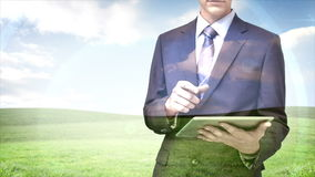 Businessman using tablet computer with field overlay stock footage