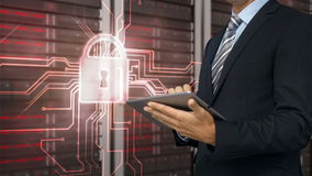 Businessman using tablet computer in front of locked server tower. Digital animation of businessman using tablet computer in front of locked server tower stock footage
