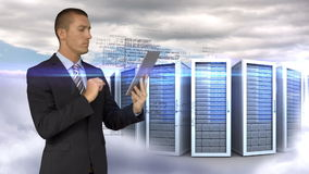 Businessman using tablet computer in front of servers towers on sky background. Digital animation of businessman using tablet computer in front of servers towers stock footage
