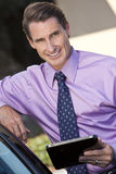 Businessman Using Tablet Computer or iPad Stock Image