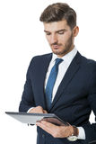 Businessman using a tablet computer Royalty Free Stock Photos