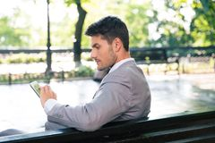Businessman using tablet computer outdoors Stock Photos