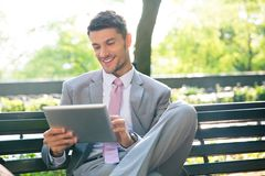 Businessman using tablet computer outdoors Royalty Free Stock Photography