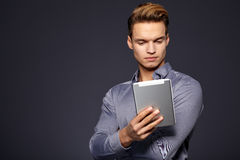 Businessman using  tablet computer -  over a grey backg Stock Photo