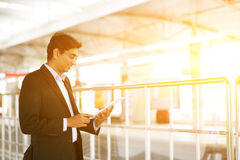 Businessman using tablet computer at railway station Royalty Free Stock Images