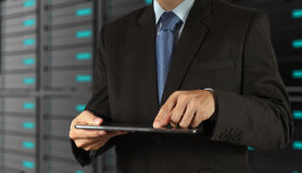 Businessman  using tablet computer and server room background Stock Image