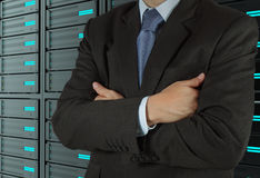 Businessman  using tablet computer and server room background Stock Photography