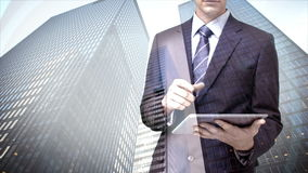 Businessman using tablet computer with skyscraper overlay stock footage
