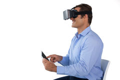 Businessman using tablet computer while wearing vr glasses Royalty Free Stock Images