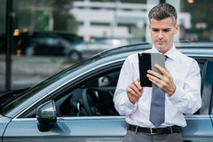 Businessman using a tablet royalty free stock photos