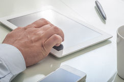 Businessman using tablet device Stock Photo