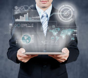 Businessman using tablet with digital visual object, business st Stock Photography