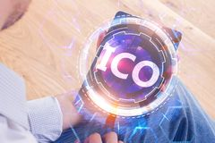 Initial coin offering concept. Businessman using tablet with glowing ICO hologram. Initial coin offering concept Royalty Free Stock Image