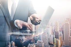 Businessman using tablet multiexposure Stock Images