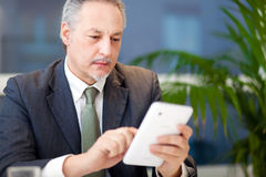 Businessman using a tablet in the office Stock Images
