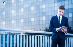 Businessman using tablet outdoor Stock Photos