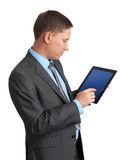 Businessman using a tablet pc Stock Photography