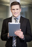 Businessman using tablet pc Royalty Free Stock Images