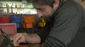 Businessman using a tablet pc in a bar stock footage