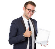 Businessman using a tablet pc, smiling Royalty Free Stock Photos