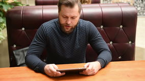 Businessman using a tablet pc and write something stock video